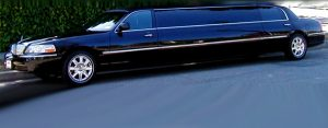 Image of black corporate Lincoln Town Car stretch limousine