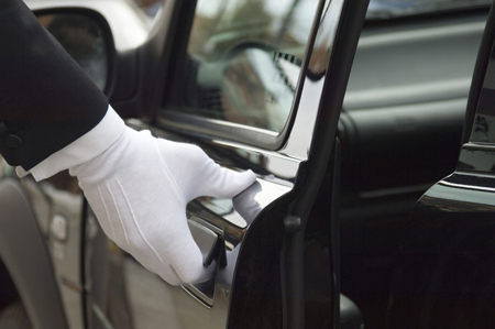 photo of limo driver opening door