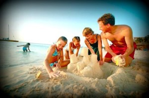 Image of family building a sand castle at the beach
